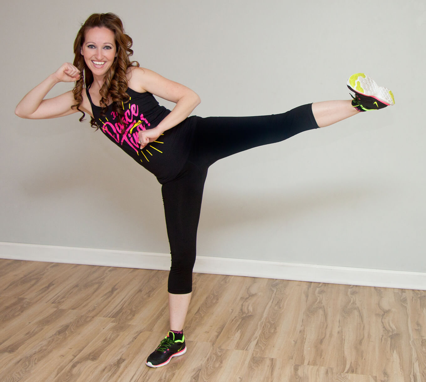 Donna shows a side kick for a fitness class