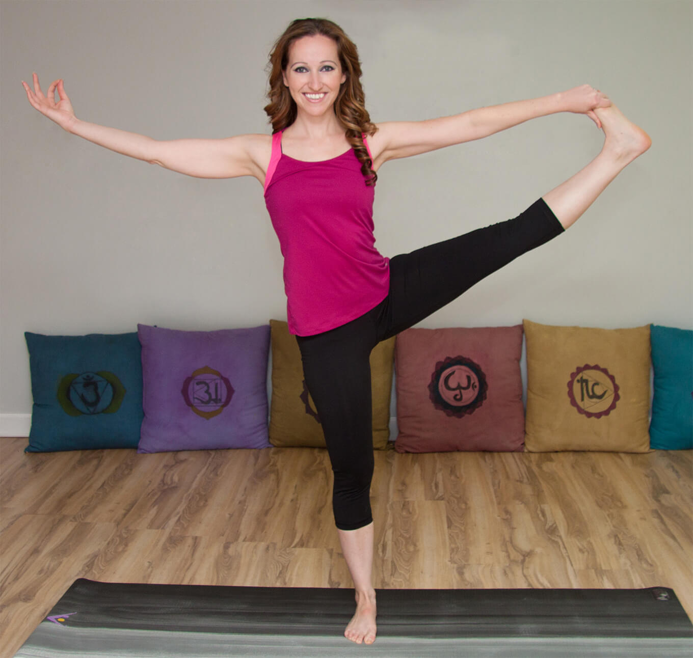 Donna demonstrating a hand to big toe extension