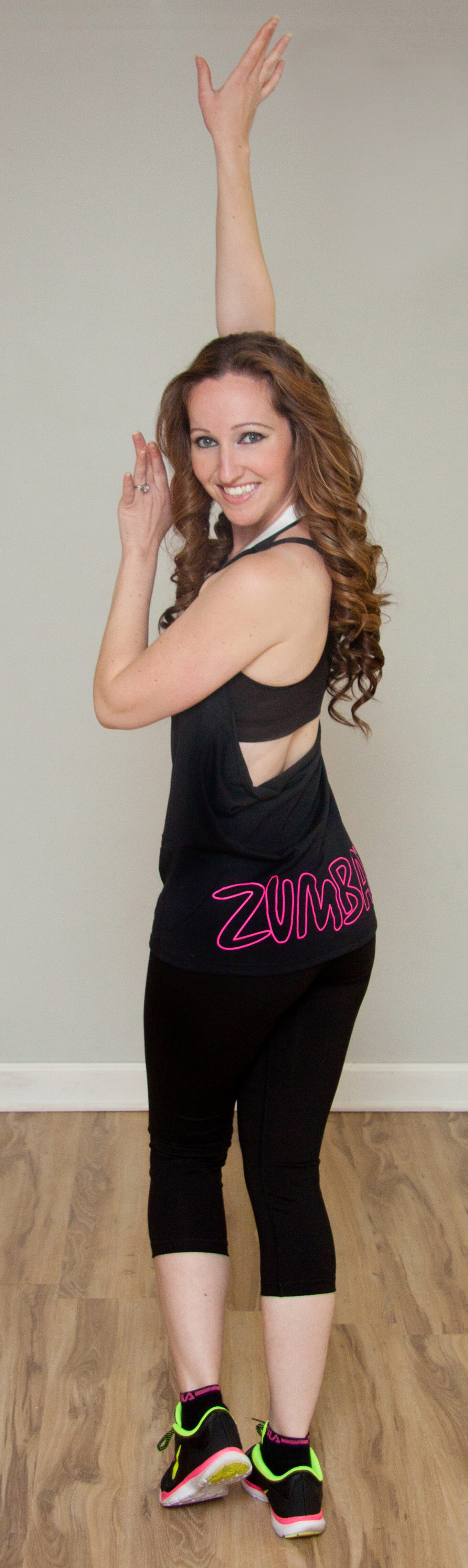 Donna performing a cha-cha Zumba move